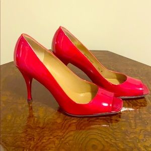 Red Patten leather peep toe pumps